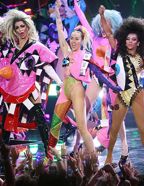 Miley Cyrus' technicolored hosting gig at the 2015 MTV Video Music Awards was as off-the-walls as expected thanks to totally crazy outfits and one insane surprise finale performance that no one could stop talking about. (Getty Images)