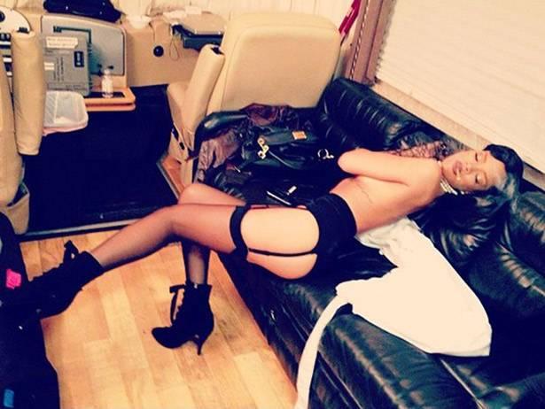 mgid:file:gsp:scenic:/international/mtvla.com/rihanna-covered-topless-in-lingerie-instagram-pic.jpg