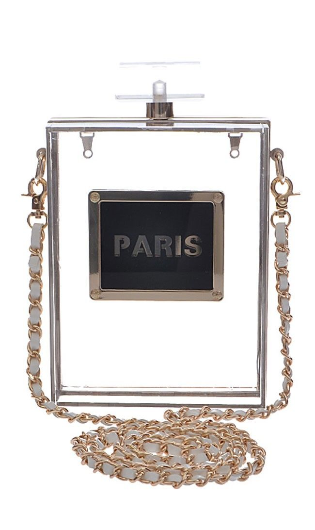 d67b853d7350 Here's Where To Get A Perfume Bottle Bag Like Miley Cyrus And ...