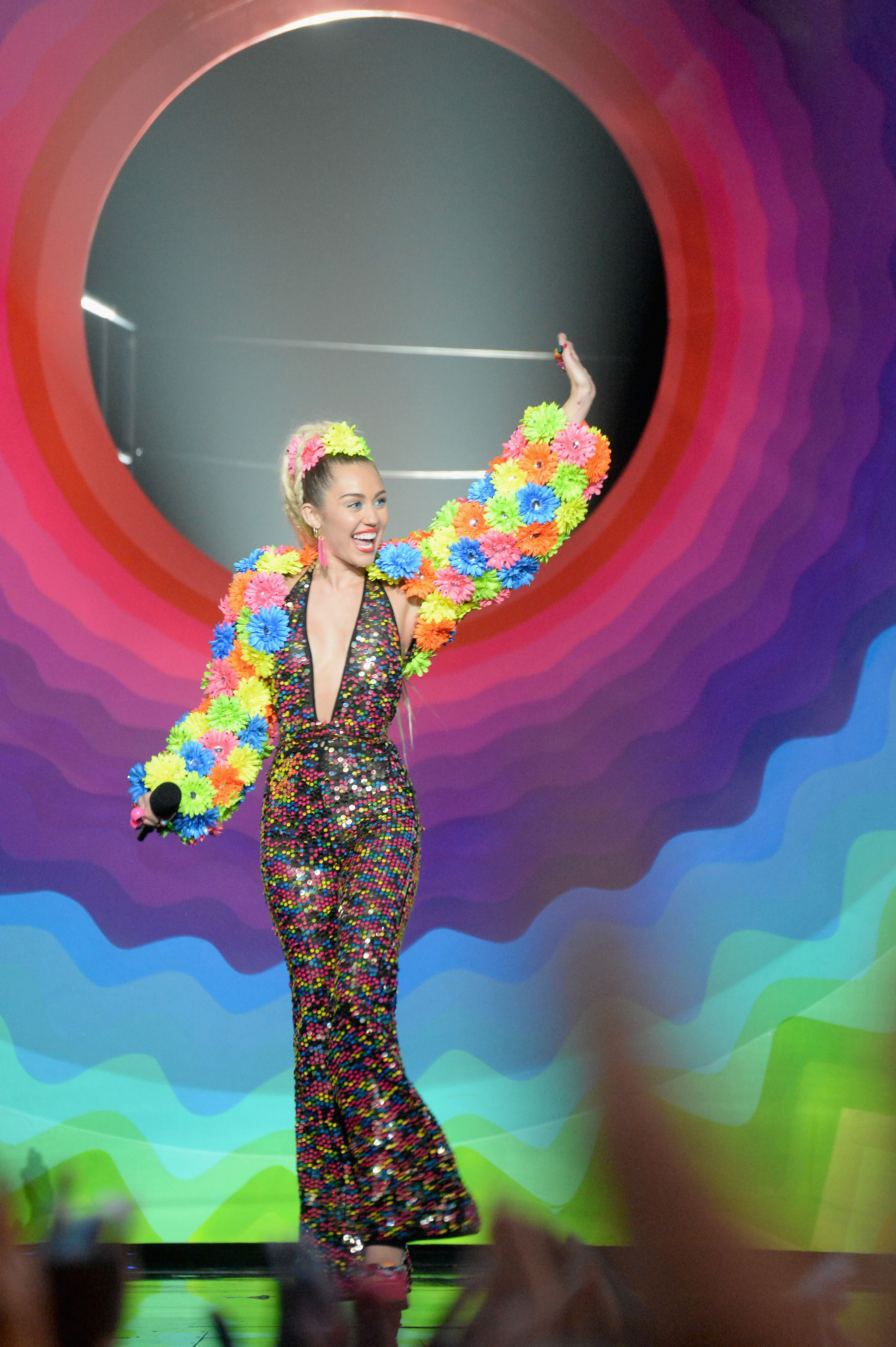 Miley Cyrus Debuts Her, Um, Colorful Art at Jeremy Scott's RunwayShow