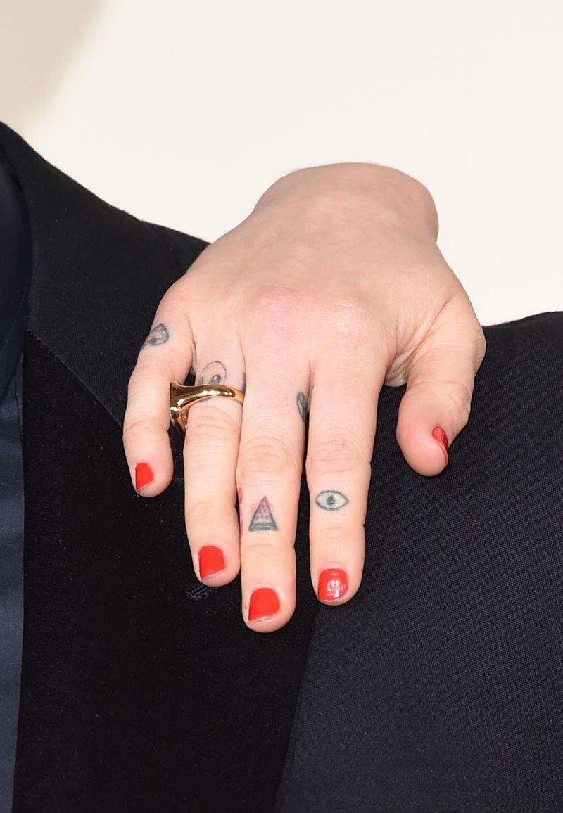 5bc17a776 23 Teeny-Tiny Celeb Finger Tattoos You Never Noticed - MTV
